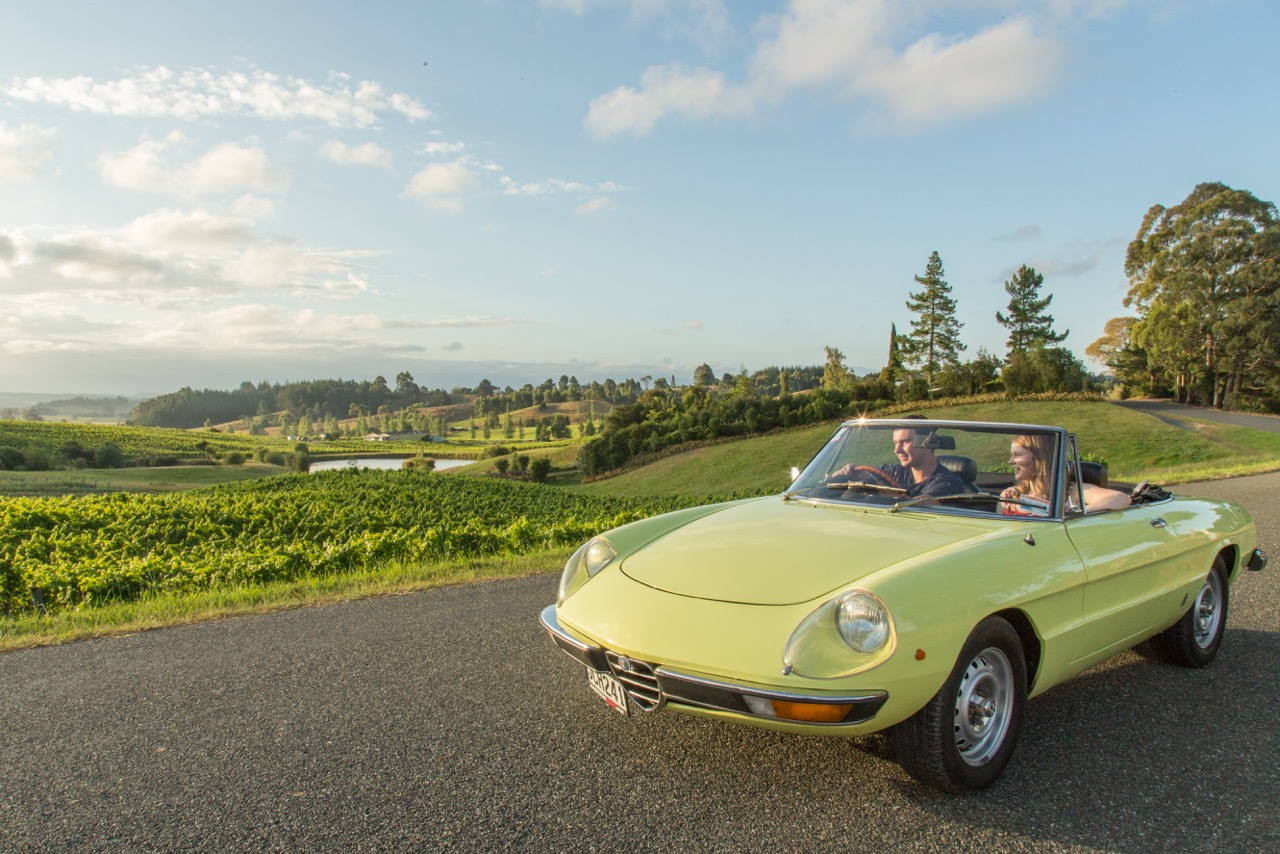 Alfa Spider S2 Rent a classic alfa spider couple overlooking nelson vineyard